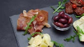 hams : sliced prosciutto or jamon meat and cheese on concrete background Stock Footage