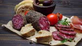 салями : salami sausage covered with pepper close up on a wood board