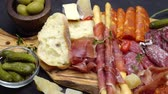 салями : meat plate - salami and chorizo sausage close up on a wood board