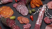 sausage slice : salami and chorizo sausage close up on dark concrete background Stock Footage