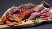 füme : salami and chorizo sausage close up on dark concrete background Stok Video