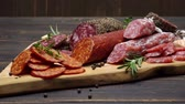 salame : salami and chorizo sausage close up on wooden background Stock Footage