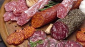 sausage slice : salami and chorizo sausage close up on wooden background Stock Footage