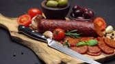 fesleğen : salami and chorizo sausage close up on dark concrete background Stok Video