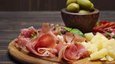 hams : sliced prosciutto, cheese and salami sausage on a wooden board