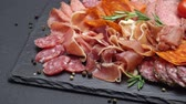 прошутто : meat plate - sliced prosciutto and salami sausage on stone serving board