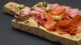 frankfurters : salami and chorizo sausage close up on dark concrete background Stock Footage
