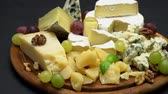 orzechy włoskie : Video of various types of cheese - parmesan, brie, roquefort