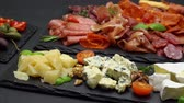 carne de porco : various types of italian food - cheese, sausage and tomatoes