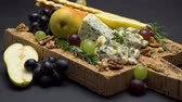 orzechy włoskie : blue cheese and fruits on cork wooden serving board