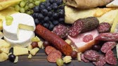 baguette : Video of various types of cheese and sausage - parmesan, brie, roquefort Stock Footage