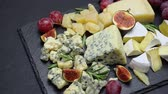dorblu : Video of roquefort or dorblu, brie, and parmesan cheese and fruits