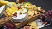 grape : Video of various types of cheese - parmesan, brie, cheddar and roquefort