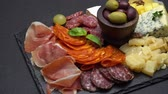 sausage slice : traditional meat and cheese plate - parmesan, meat, sausage and olives