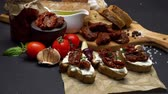 dry cured : bruschetta with Canned Sundried or dried tomato halves on craft pepper