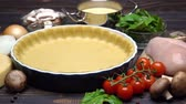 чеддер : shortbread dough for baking quiche tart and ingredients in baking form