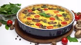 noz moscada : Baked homemade quiche pie in ceramic baking form Stock Footage