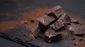 blokken : Dark or milk organic chocolate pieces on dark concrete background