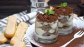 cynamon : Classic tiramisu dessert in a glass on wooden background Wideo