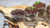 grano de cafe : Classic tiramisu dessert in a glass on dark concrete background