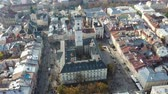 Aerial drone video of Lviv Old City center - roofs and streets, city hall Ratusha Filmati Stock