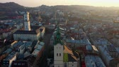 hall : Aerial drone video of Lviv Old City center - roofs and streets, city hall Ratusha Stock Footage