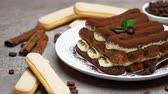 grano de cafe : Classic tiramisu dessert on ceramic plate and savoiardi cookies on concrete background