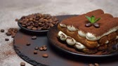 grano de cafe : Classic tiramisu dessert on ceramic plate on concrete background