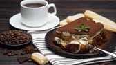 レイヤード : portion of Classic tiramisu dessert and savoiardi cookies on wooden background