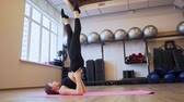 amatör : 4x slow motion video of Beautiful young woman working out and stretching indoors