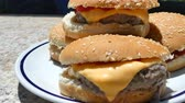 чеддер : Dolly view of plate full of cheeseburgers in garden in sunny lunch time