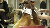 Young woman is having her hair dyed Stock Footage