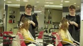 Young woman is having her hair flocks dyed in salon