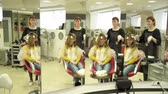 Hairdresser is dyeing girls hair flocks in front of the mirror Stock Footage