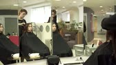 Hairdresser is preparing womans hair for the procedure