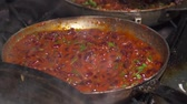 borgonha : Red kidney beans frying in red sauce in pan,slow motion
