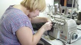 parecer : Blonde woman working on the clothing factory Stock Footage