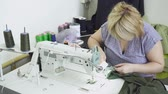 parecer : Woman creating clothes on the clothing factory with sewing machine Stock Footage