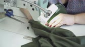 parecer : Woman creating clothes on the clothing factory closeup