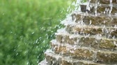 ceramic : Pure water running in the fountain during the summer, closeup, slow motion Stock Footage