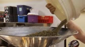 elaboração : Coffee Bean Prep Roast. Three Varied Clips of the preparation for roasting the raw coffee beans. Dolly Shots