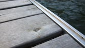 se movendo para cima : Dolly Close Up Dock Out To Water. a close up shot of a dock with a dollying camera move towards the water and back again. focus on dock.