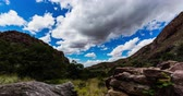 típico : Between Mountain Peaks Time Lapse. a time lapse up in the mountains of New Mexico in Las Cruces. Beautiful day with nice clouds flying overtop Stock Footage