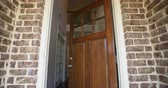 chodba : Front Home Entrance Low Angle Door Open Rise Up. rising low angle shot of the front entrance as the door opens to reveal the hallway of a modern residential home