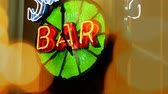 tipo de letra : Generic Neon Bar Sign Lights. a unique lime neon generic bar clock sign in the window of a bar Stock Footage