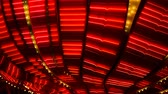 incandescente : Red Neon Ceiling Pattern Blinking Las Vegas. Red line neon blinking animated ceiling pattern of a casino on the Las Vegas strip Stock Footage