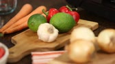 приправа : Cooking Ingredients Rack Focus. a close up racking focus shot of carrots lemons, pepper, garlic and onions on cutting boards