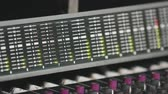 estéreo : Close Up Tilt Up and Down of Audio Board Knobs. hand held shot tilting up and tilting down on an audio board