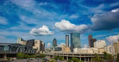 Downtown Atlanta Skyline Daytime Timelapse. a daytime skyline of the city of Atlanta with large clouds