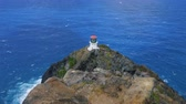 Hawaii Lighthouse on Rocks from Above. a lowering and rising view from rocks of a lighthouse on makapuu trail in Hawaii